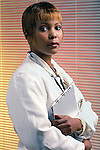 portrait of African American doctor holding patient records