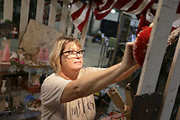 Christi Tevebaugh of Mineola, Texas displays items at her booth called Just Piddlin, Thursday, October 7, 2021 at the Benton County Fairgrounds in Bentonville. The annual Vintage Market days makes its return to the fairgrounds featuring dozens of vendors selling vintage-inspired goods. The market will run through the weekend. Check out nwaonline.com/211008Daily/ for today's photo gallery. <br /> (NWA Democrat-Gazette/Charlie Kaijo)