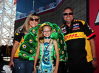 Oct. 30, 2011; Las Vegas, NV, USA: NHRA funny car driver Jeff Arend (right) with wife Windy Arend and daughter Jenna Arend during the Big O Tires Nationals at The Strip at Las Vegas Motor Speedway. Mandatory Credit: Mark J. Rebilas-