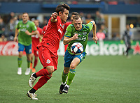 SEATTLE, WA - NOVEMBER 10: Toronto FC forward Tsubasa Endoh #31 receives a pass in front of Seattle Sounders defender Brad Smith #11 during a game between Toronto FC and Seattle Sounders FC at CenturyLink Field on November 10, 2019 in Seattle, Washington.