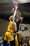 SIOUX FALLS, SD - MARCH 7: Marvin Nesbitt Jr. #33 of the UMKC Kangaroos shoots over Sam Griesel #5 of the North Dakota State Bison during the Summit League Basketball Tournament at the Sanford Pentagon in Sioux Falls, SD. (Photo by Dave Eggen/Inertia)