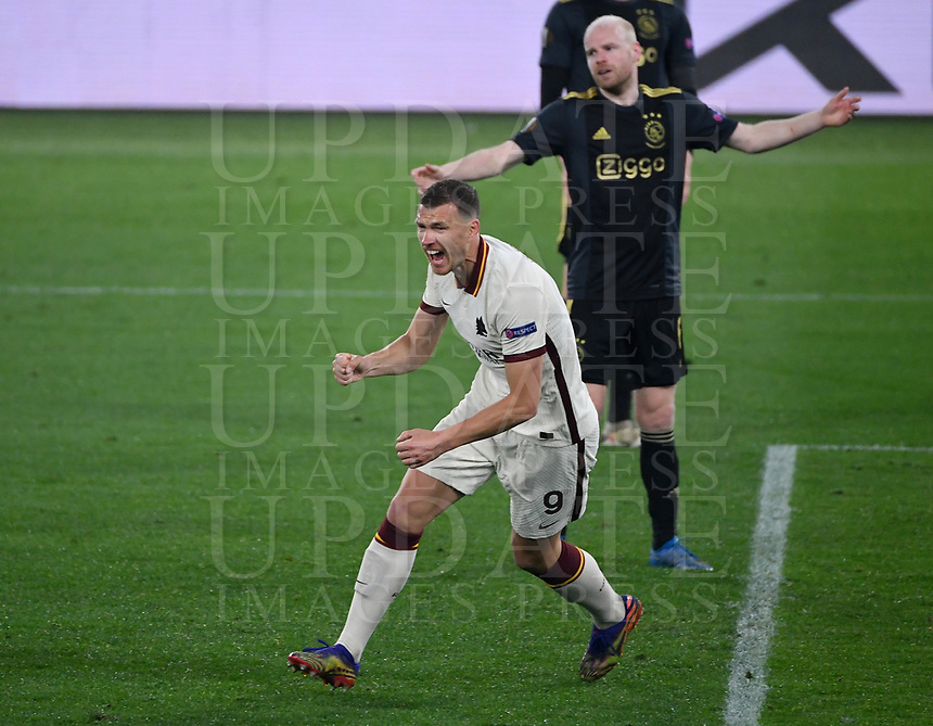 Football: Europa League - quarter final 2nd leg AS Roma vs Ajax, Olympic Stadium. Rome, Italy, March 15, 2021.<br /> Roma's Edin Dzeko (in front of) celebrates after scoring during the Europa League football match between Roma at Rome's Olympic stadium, Rome, on April 15, 2021.  <br /> UPDATE IMAGES PRESS/Isabella Bonotto