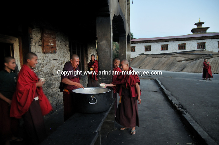 Young lamas, who are students of Kharchhu Monastry (which is a buddhist school and college) having their dinner in the evening. These lamas lead a very modest life and have simple food three times a day. Arindam Mukherjee..