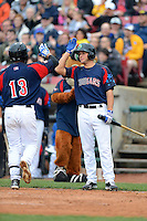 Kane County Cougars third baseman David Bote #6 congratulates Gioskar Amaya #13 after a home run during a game against the Beloit Snappers May 26, 2013 at Fifth Third Bank Ballpark in Geneva, Illinois.  Beloit defeated Kane County 6-5.  (Mike Janes/Four Seam Images)