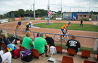 13 SEP 2014 - IPSWICH, GBR - Spectators watch a heat of the 2014 British Open Club Cycle Speedway Championships at Whitton Sports & Community Centre in Ipswich, Great Britain (PHOTO COPYRIGHT © 2014 NIGEL FARROW, ALL RIGHTS RESERVED)
