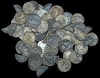 BNPS.co.uk (01202 558833)<br /> Pic: DNW/BNPS<br /> <br /> Mint silver penny's and half penny's (literally pennys cot in half) of King Ethelred II.<br /> <br /> A builder is celebrating today after an enormous hoard of silver coins he unearthed sold for £90,000.<br /> <br /> Don Crawley was searching farmland with his metal detector when he stumbled upon the buried treasure.<br /> <br /> He dug up 99 silver coins - 81 pennies and 18 cut halfpennies - all dating back to Anglo Saxon England and the reign of King Ethelred II from 978-1016AD.<br /> <br /> The discovery was made on farmland in Suffolk and research has established that the site used to be the grounds of a long-forgotten Saxon church. Specialists even later uncovered the remains of human bones from the site dating back over 1,000 years.<br /> <br /> Don's hoard went under the hammer with London auctioneers Dix Noonan Webb - with the coins substantially out-performing their £50,000 pre-sale estimate.