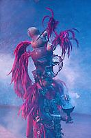 "Pre-Hispanic Mayan Figure Carrying Incense, Xcaret Performance, ""Mexico Espectacular"".  Playa del Carmen, Riviera Maya, Yucatan, Mexico."