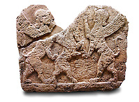 Picture of a Neo-Hittite orthostat describing the legend of Gilgamesh from Karkamis, Turkey. Ancora Archaeological Museum. Mythological Scene of 2 Spinxes standing on their back legs either side of a winged horse which is also standing on its rear legs. 5