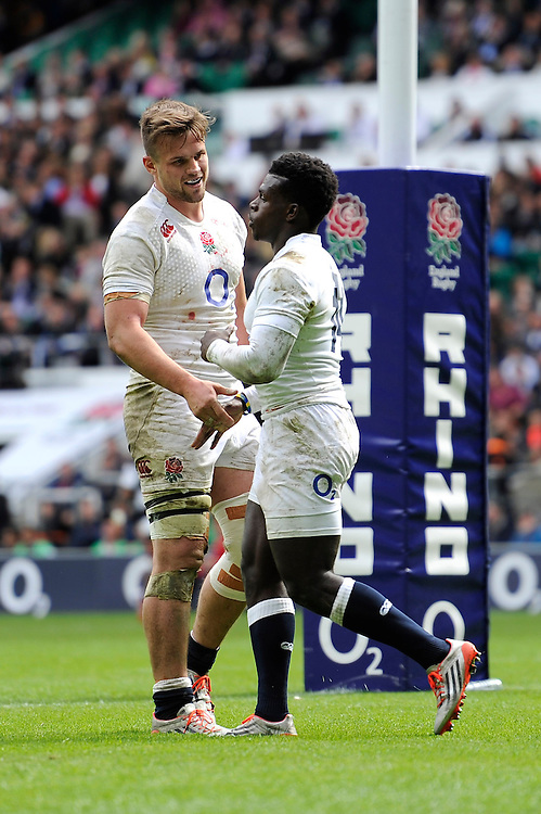 Jack Clifford of England congratulates Christian Wade of England on his opening try during the match between England and Barbarians at Twickenham Stadium on Sunday 31st May 2015 (Photo by Rob Munro)