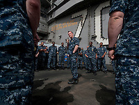 120302-N-DR144-660 ARABIAN GULF (March 2, 2012) Commander, Carrier Strike Group (CSG) 1 Rear Admiral Thomas K. Shannon addresses Sailors during a CSG-1 all hands call on the flight deck aboard the Nimitz-class aircraft carrier USS Carl Vinson (CVN 70). Carl Vinson and Carrier Air Wing (CVW) 17 are deployed to the U.S. 5th Fleet area of responsibility.  (U.S. Navy photo by Mass Communication Specialist 2nd Class James R. Evans/Released)