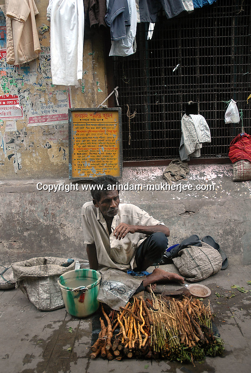 A man waiting for his customers to sell black magic plants which are to be worn around the neck or hands for better prospect in future. Kolkata, West Bengal, India 7/18/2007.  Arindam Mukherjee/Landov