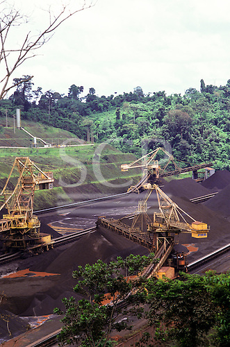 Carajas mine, Para State, Brazil. Stockpiles of iron ore at the railhead terminal.