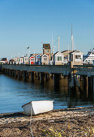 Rowboat and excursion booths along MacMillan Wharf, Provincetown, Cape Cod, Massachusetts, USA