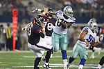 Dallas Cowboys defensive end Jabari Fletcher (69) and Houston Texans quarterback T.J. Yates (13) in action during the pre-season game between the Houston Texans and the Dallas Cowboys at the AT & T stadium in Arlington, Texas. Houston defeats Dallas 24 to 6.