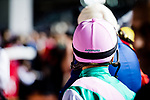 DUBAI, UNITED ARAB EMIRATES - MARCH 25: Mike Smith (pink hat), in the walking circle prior to the Dubai World Cup at Meydan Racecourse during Dubai World Cup Day on March 25, 2017 in Dubai, United Arab Emirates. (Photo by Douglas DeFelice/Eclipse Sportswire/Getty Images)