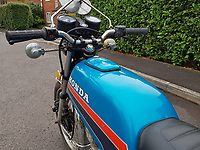 BNPS.co.uk (01202) 558833. <br /> Pic: Charterhouse/BNPS<br /> <br /> A 1981 motorbike with no mileage because it was confiscated by the teenage owner's dad and locked in the garden shed has gone on sale. <br /> <br /> The thirty year old Honda CB100-N was bought brand new by the youngster during his youth while living with his parents. <br /> <br /> However his boyhood fantasy of riding a motorcycle never materialised because his father banned him from using it.