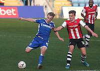 Kyle Dempsey of Gillingham in possession as Exeter's Archie Collins looks on during Gillingham vs Exeter City, Emirates FA Cup Football at the MEMS Priestfield Stadium on 28th November 2020