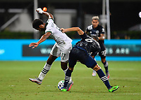 LAKE BUENA VISTA, FL - AUGUST 01: Jeremy Ebobisse #17 of the Portland Timbers is challenged by Alexander Callens #6 of New York City FC during a game between Portland Timbers and New York City FC at ESPN Wide World of Sports on August 01, 2020 in Lake Buena Vista, Florida.