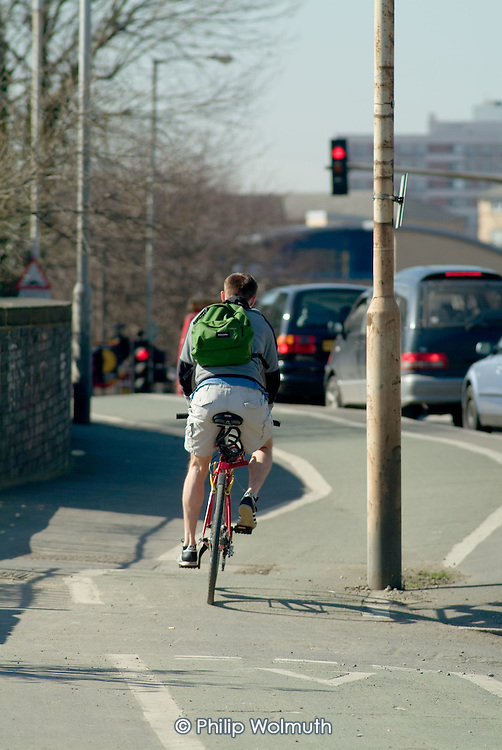 A cyclist on a cycle lane in the London Borough of Newham.