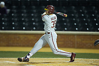 Cal Raleigh (35) of the Florida State Seminoles follows through on his swing against the Wake Forest Demon Deacons at David F. Couch Ballpark on March 9, 2018 in  Winston-Salem, North Carolina.  The Seminoles defeated the Demon Deacons 7-3.  (Brian Westerholt/Four Seam Images)