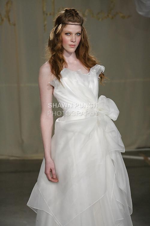 Model walks runway in a Sweet Bay Long wedding dress by Carol Hannah Whitfield, for the Carol Hannah Spring Summer 2012 Bridal collection runway show.