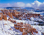 Bryce Canyon National Park, UT<br /> Fresh snow covers the hoodoos and cliffs of the Queens Garden from Sunset Point with Boat Mesa in the distance