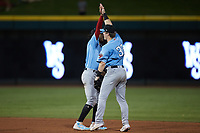 Kellen Strahm (33) of the Hickory Crawdads high fives teammate Jonathan Ornelas (3) after their extra inning win over the Winston-Salem Dash at Truist Stadium on July 10, 2021 in Winston-Salem, North Carolina. (Brian Westerholt/Four Seam Images)
