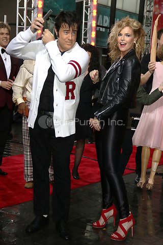 NEW YORK, NY- OCTOBER 31: Carson Daly and Savannah Guthrie as Danny and Sandy from Grease at NBC's Today Show Annual Halloween Episode at Rockefeller Center in New York City on October 31, 2019. credit: RW/MediaPunch
