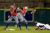 Blake Kelso #5 of the Houston Cougars tries to put the tag on Dylan Petrich #27 of the Texas A&M Aggies in the 2009 Houston College Classic at Minute Maid Park March 1, 2009 in Houston, TX.  The Aggies defeated the Cougars 5-3. (Photo by Brian Westerholt / Four Seam Images)