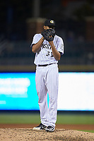 Charlotte Knights relief pitcher Juan Minaya (31) looks to his catcher for the sign against the Scranton/Wilkes-Barre RailRiders at BB&T BallPark on August 14, 2019 in Charlotte, North Carolina. The Knights defeated the RailRiders 13-12 in ten innings. (Brian Westerholt/Four Seam Images)