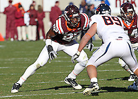 Nov 27, 2010; Charlottesville, VA, USA;  Virginia Tech Hokies defensive end Steven Friday (82) blocks Virginia Cavaliers tight end Colter Phillips (89) during the game at Lane Stadium. Virginia Tech won 37-7. Mandatory Credit: Andrew Shurtleff-