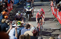 Tosh Van der Sande (BEL/Lotto-Soudal) & Steve Cummings (GBR/DimensionData) are among the last surviving escapers up the infamous Mur de Huy (1300m/9.8%)<br /> <br /> Flèche Wallonne 2016