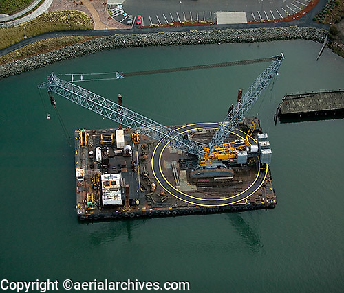 aerial photograph crane on barge in estuary at Port of Oakland, California