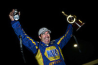 Sept. 16, 2012; Concord, NC, USA: NHRA funny car driver Ron Capps celebrates after winning the O'Reilly Auto Parts Nationals at zMax Dragway. Mandatory Credit: Mark J. Rebilas-