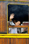 Loughing girl looking out of a historic steam train at Paranapiacaba station; near Sao Paulo, Brazil. In 1856 the British-owned Sao Paulo Railway Company was awarded the concession to operate a rail line between the port of Santos and Jundai, 70km north of Sao Paulo city, in what was then a developing coffee-growing region. The 139km line was completed in 1867, remaining under British control until 1947. Overcoming the near-vertical incline of the Serra do Mar that separates the interior of the state from the coast, the line was using the largest funicular system in the world and was regarded as an engineering miracle. --- No releases available.