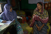 """Sanjida interviewing Rihaa*, 35, for a homeworker study conducted by CCR CSR and Save the Children. Rihaa*, 35, lives in a slum in Dhaka with her husband and 3 children. She and her youngest daughter Sumaiya*, 15, work from home doing ornamental stitching, dress decoration and flower chains. """"My daughter works about 2 hours a day to contribute to our family income, but I would never take her out of school"""", says Rihaa*. """"I want all of my children to be independent and get the education that I have never been able to receive."""""""
