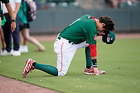 Jaxx Groshans (1) of the Greenville Drive takes a quiet moment before a game against the Rome Braves on Wednesday, August 4, 2021, at Fluor Field at the West End in Greenville, South Carolina. (Tom Priddy/Four Seam Images)