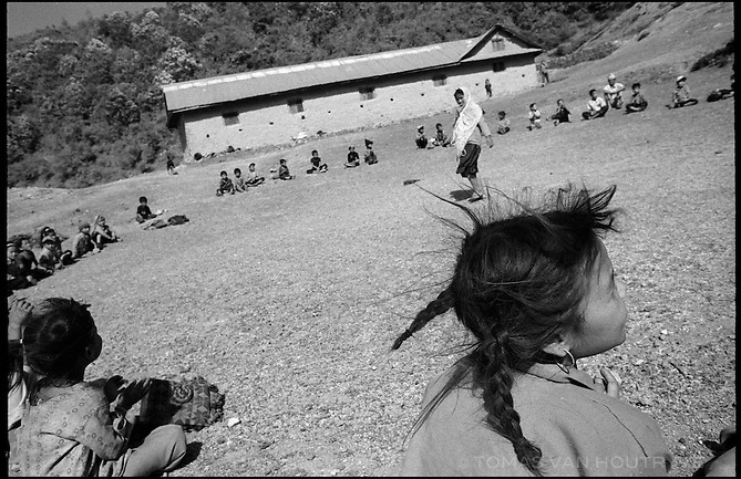 """Children play a game called """"choose the leader"""" at the Bhagawati Primary School,  the Maoist controlled village of Dahawan in Nepal on 16 June, 2005. Due to conflict related disruptions and strikes called by the Moaists, the school was open only 140 of the required 180 days during the school year.<br />"""