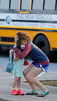 Bella Rose Robinson, a kindergarten student at The New School, receives a hug Thursday, October 1, 2020, before she enters school for a day of classes in Fayetteville. Check out nwadg.com/photos for a photo gallery.(NWA Democrat-Gazette/David Gottschalk)