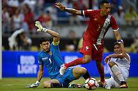 Orlando, FL - Monday June 06, 2016: Bolivia goalkeeper Carlos Lampe (1) and Panama forward Blas Pérez (7) during a Copa America Centenario Group D match between Panama (PAN) and Bolivia (BOL) at Camping World Stadium.