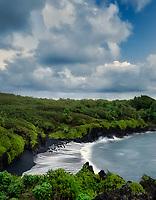 Waves on Black Sand Beach. Waianapanapa Stater Park and beach. Maui, Hawaii