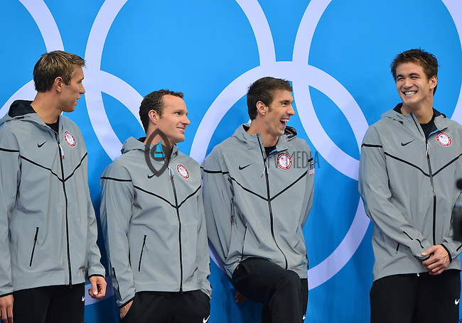 August 04, 2012..Matt Grevers, Brendan Hansen, Michael Phelps, Nathan Adrian on the podium for Men's 4x100m Medley Relay award ceremony at the Aquatics Center on day eight of 2012 Olympic Games in London, United Kingdom.