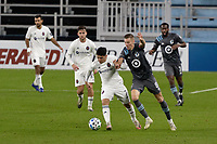ST PAUL, MN - NOVEMBER 4: Ignacio Aliseda #7 of Chicago Fire FC and Jan Gregus #8 of Minnesota United FC go for the ball during a game between Chicago Fire and Minnesota United FC at Allianz Field on November 4, 2020 in St Paul, Minnesota.