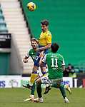 Hibs v St Johnstone…01.05.21  Easter Road. SPFL<br />Craig Bryson gets above Mike Newell<br />Picture by Graeme Hart.<br />Copyright Perthshire Picture Agency<br />Tel: 01738 623350  Mobile: 07990 594431