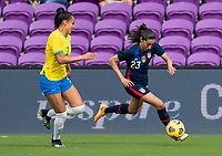 ORLANDO, FL - FEBRUARY 21: Kathellen #2 of Brazil defends Christen Press #23 of the USWNT during a game between Brazil and USWNT at Exploria Stadium on February 21, 2021 in Orlando, Florida.