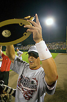 South Carolina OF Whit Merrifield lifts the championship trophy following Game Two of the NCAA Division One Men's College World Series Finals on June 29th, 2010 at Johnny Rosenblatt Stadium in Omaha, Nebraska.  (Photo by Andrew Woolley / Four Seam Images)