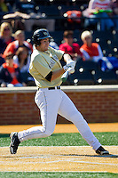Matt Conway (25) of the Wake Forest Demon Deacons makes contact with the baseball against the Virginia Cavaliers at Wake Forest Baseball Park on April 6, 2013 in Winston-Salem, North Carolina.  (Brian Westerholt/Four Seam Images)