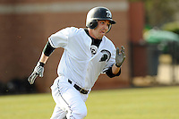 Second baseman Erik Samples (1) of the University of South Carolina Upstate Spartans runs toward first in a game against the Winthrop University Eagles on Wednesday, March 4, 2015, at Cleveland S. Harley Park in Spartanburg, South Carolina. Upstate won, 12-3. (Tom Priddy/Four Seam Images)