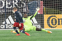 FOXBOROUGH, MA - NOVEMBER 1: Bill Hamid #24 of DC United deflects a shot from Adam Buksa #9 of New England Revolution during a game between D.C. United and New England Revolution at Gillette Stadium on November 1, 2020 in Foxborough, Massachusetts.
