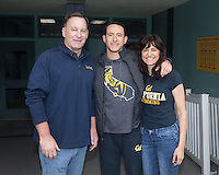 BERKELEY, CA - Feb. 18, 2017: Cal's Dillon Williams with his parents on Senior Day.  Cal Men's Swimming and Diving competed against Stanford at Spieker Aquatics Complex.